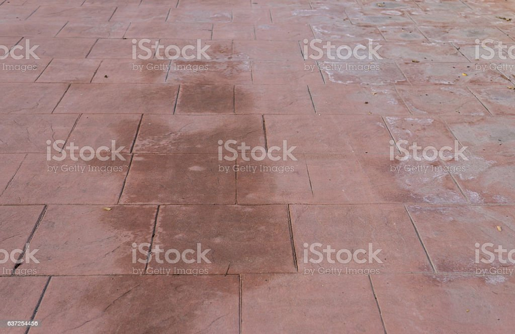 Stamped concrete floor outdoor pavements appearance of natural stone, wet stock photo