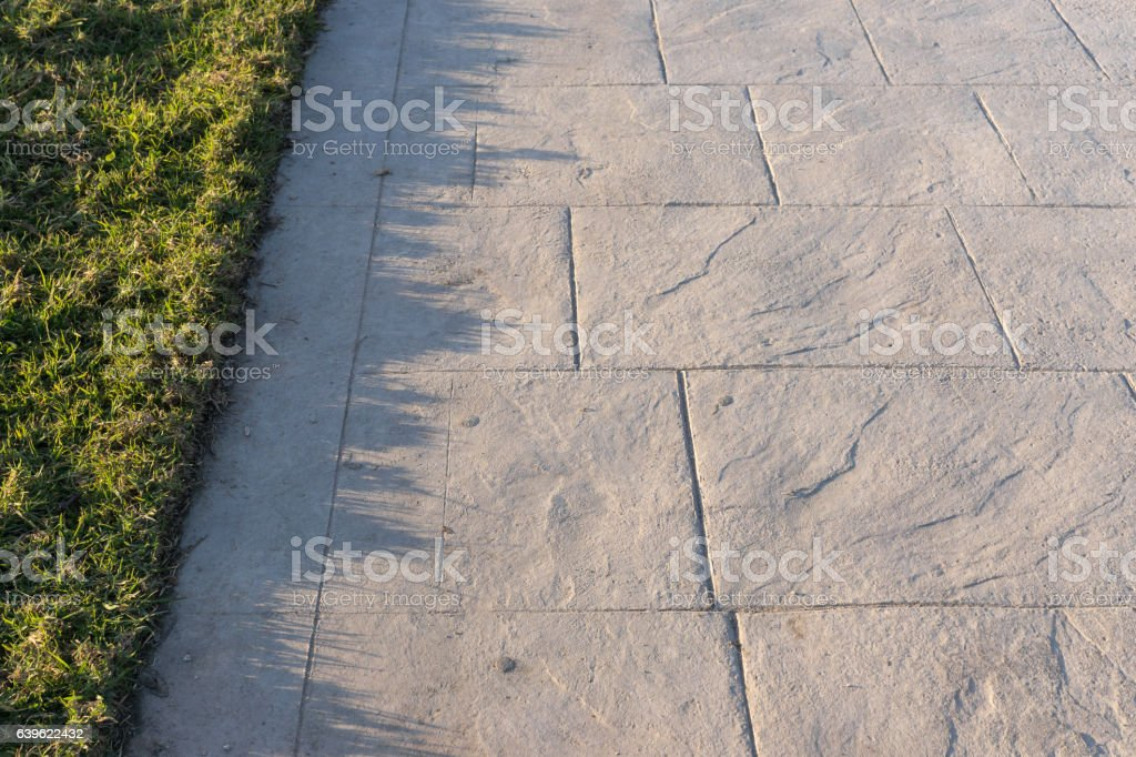 Stamped concrete pavement outdoor slate stone pattern, decorative appearance colors stock photo