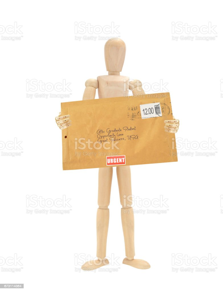 Stamped Manilla Envelope Wood Mannequin stock photo