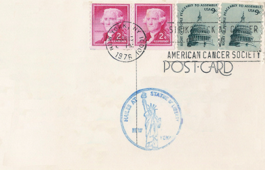 USA - CIRCA 1976: Stamps printed in USA on postcard with Statue of Liberty Stamp  shows Jefferson and Parliament Building, circa 1953
