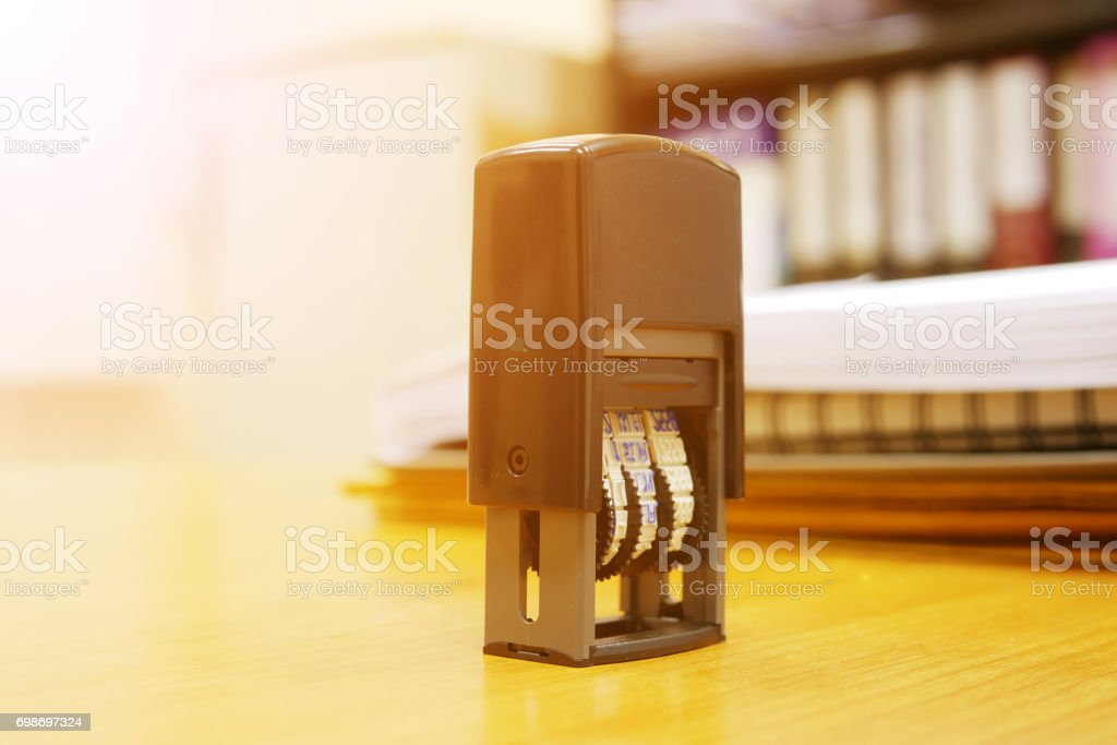 Stamper on office desk stock photo