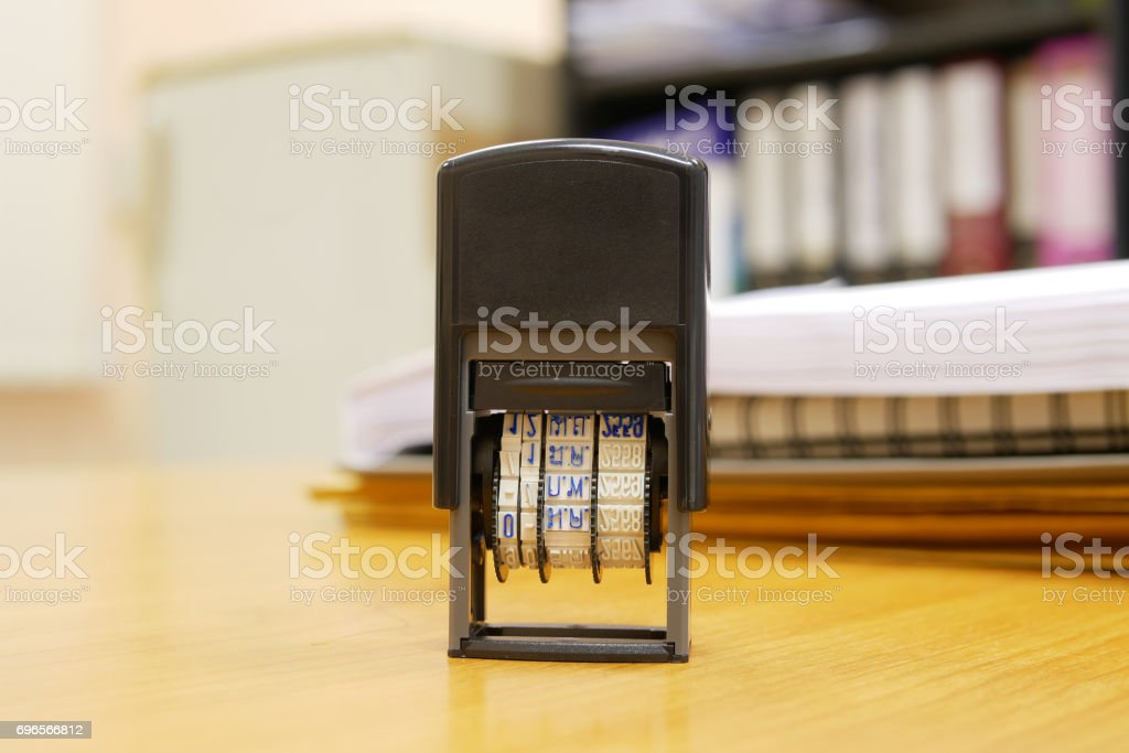 Stamper on office table as selective focus stock photo