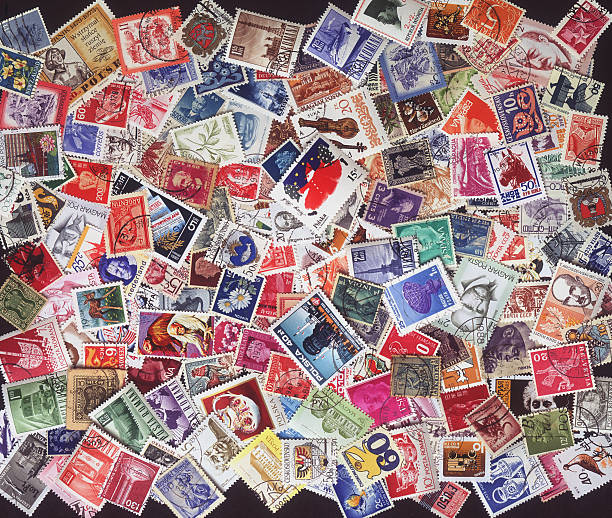 stamps from around the world Colorful vintage, cancelled, stamps from around the world. stamp stock pictures, royalty-free photos & images