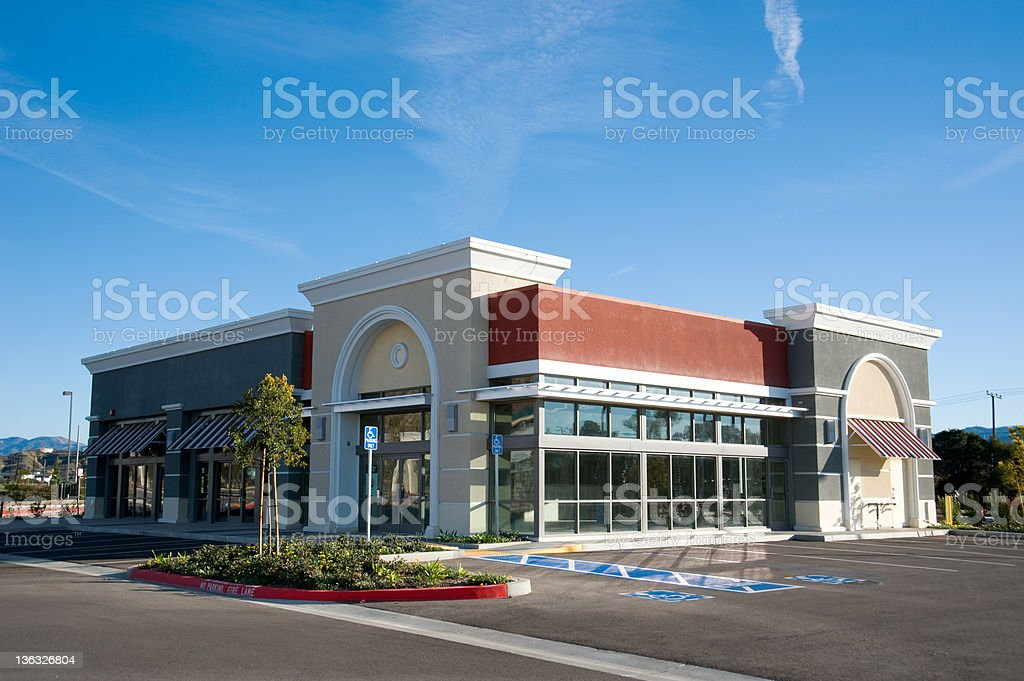Stand alone shopping center and parking lot stock photo