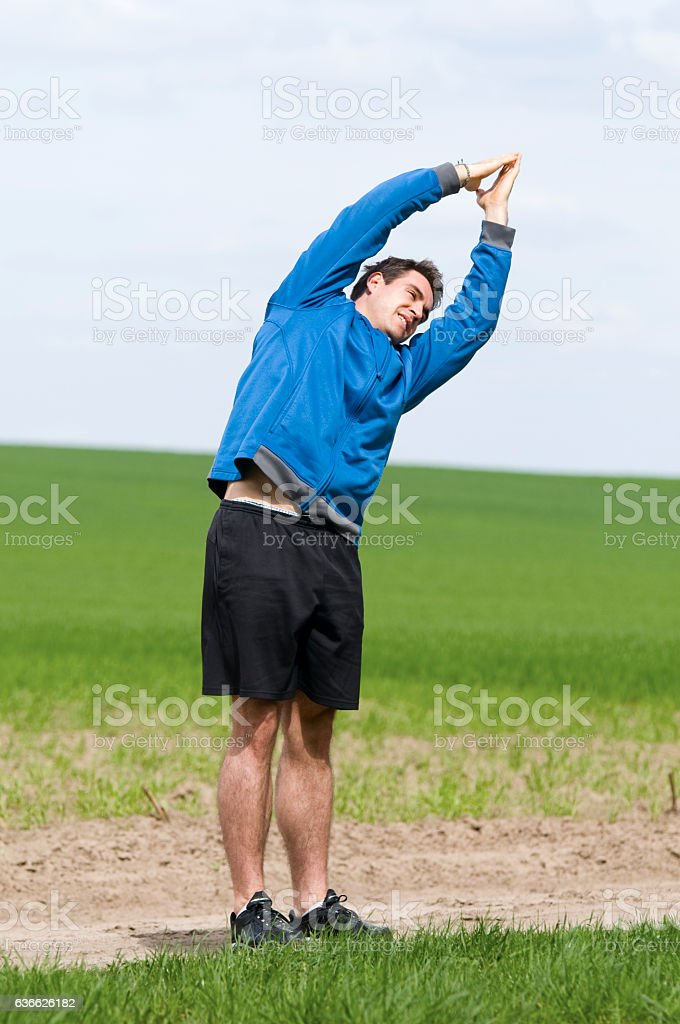 stand andt stretch_vertical stock photo