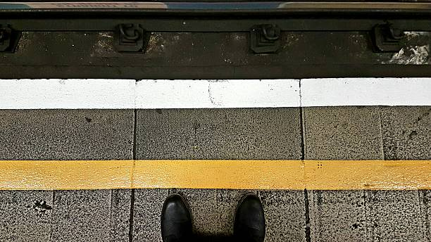 Stand Behind The Yellow Line stock photo
