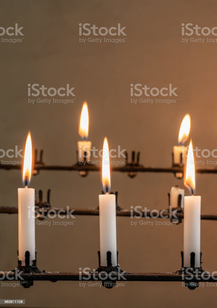 Stand of burning prayer candles in old church - Royalty-free Architecture Stock Photo