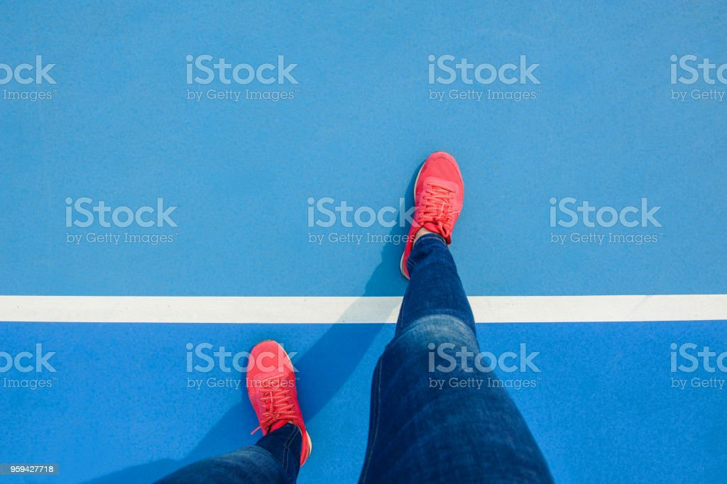 stand on tennis court floor stock photo