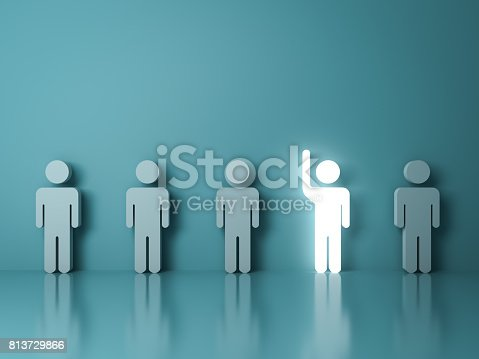 807463794istockphoto Stand out from the crowd and different concept , One glowing light man raising his hand among other people on light green background with reflections and shadows . 3D rendering 813729866