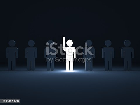 807463794istockphoto Stand out from the crowd and different concept , One glowing light man raising his hand among other dim people in the row on dark blue background with shadows . 3D rendering 822055178