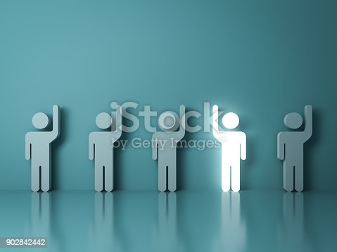 807463794istockphoto Stand out from the crowd and different concept , One glowing light man raising his right hand among other left hand people on light green background with reflections and shadows 902842442