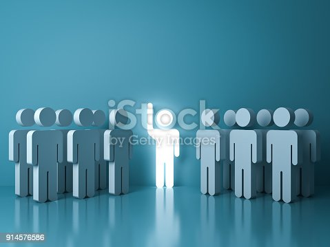 807463794istockphoto Stand out from the crowd and different concept , One glowing light man raising his hand among other people on light green pastel color background with reflections and shadows 914576586