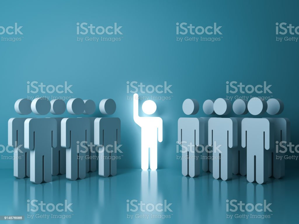 Stand out from the crowd and different concept , One glowing light man raising his hand among other people on light green pastel color background with reflections and shadows stock photo