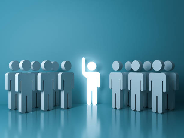 stand out from the crowd and different concept , one glowing light man raising his hand among other people on light green pastel color background with reflections and shadows - leadership stock pictures, royalty-free photos & images