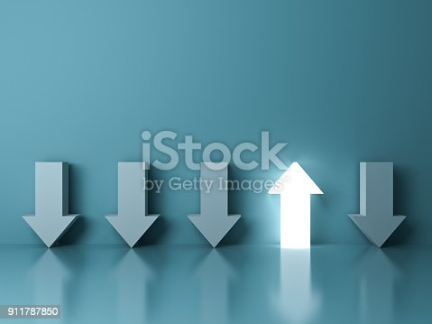 istock Stand out from the crowd and different concept , One glowing light up arrow among other down arrows on green pastel color background with reflections and shadows 911787850
