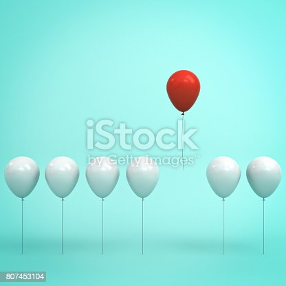 807463794istockphoto Stand out from the crowd and different concept , One red balloon flying in the air away from other white balloons on light green pastel color background with reflections and shadows . 3D rendering 807453104