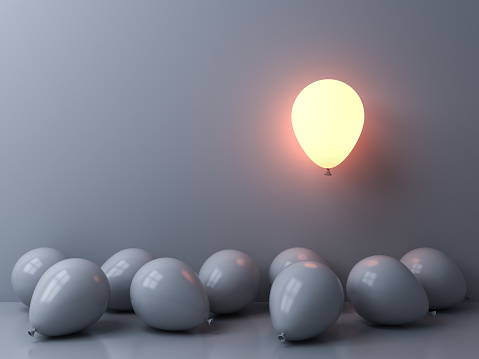 istock Stand out from the crowd and different concepts One light balloon glowing and floating above other white balloons on white wall background with window reflections and shadows 3D rendering 1150792085