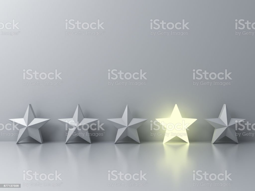 Stand out from the crowd and different creative idea concepts , One glowing star standing among other dim stars on grey background with reflections and shadows . 3D render stock photo