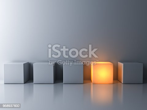 istock Stand out from the crowd and think different concepts , One glowing box or cube standing among white dim cubes on dark white background with reflections and shadows . 3D rendering 958937832