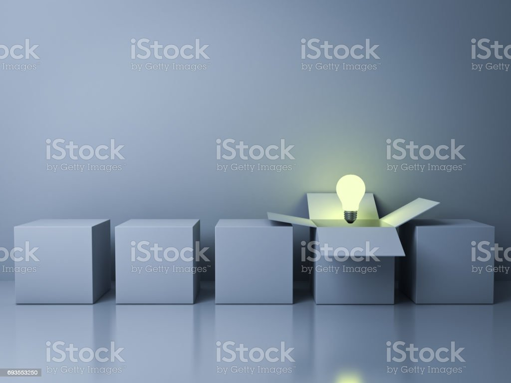 Stand out from the crowd different creative idea concepts , One white opened box with idea light bulb glowing among close square boxes on cyan background in the row with reflections stock photo