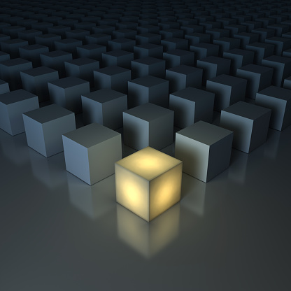 istock Stand out from the crowd , Different creative idea , Leadership concepts , One glowing yellow light cube among dim cubes on dark grey background with reflections and shadows . 3D render 693551028