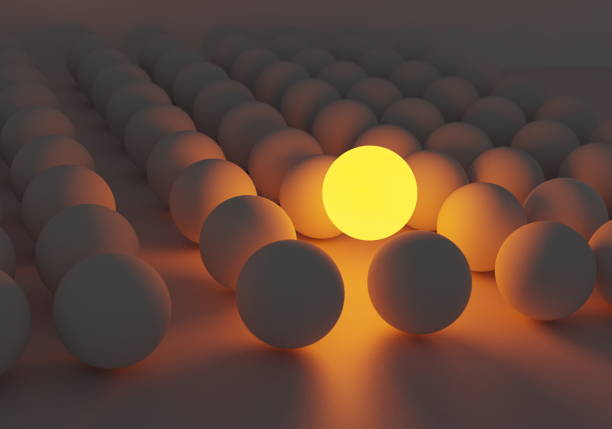 Stand out from the crowd different light color sphere 3d render stock photo