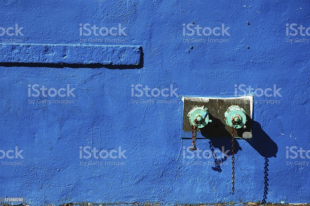 Stand pipe on the blue wall. stock photo