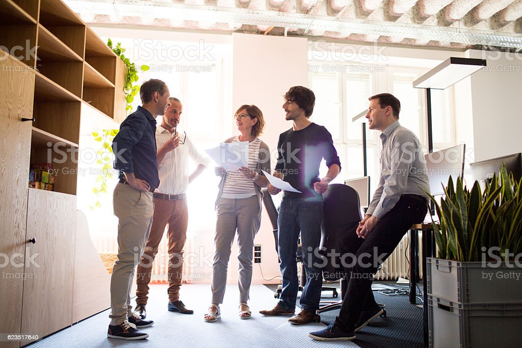 Stand up meeting of entrepreneurs in an office space stock photo