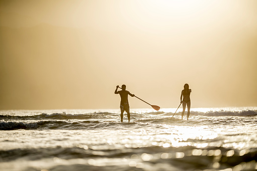 istock Stand Up Paddle Boarding at Dusk 486337440