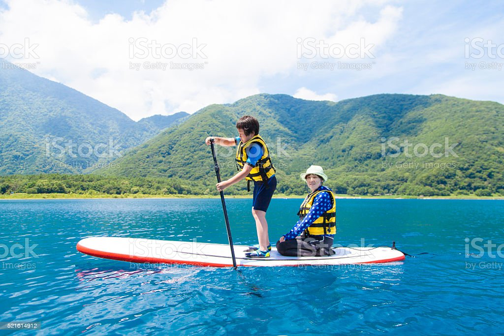 Stand up paddle boarding family stock photo
