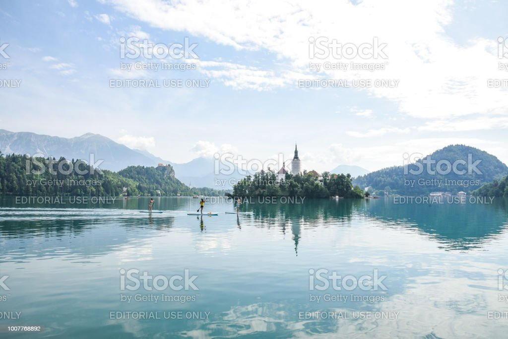 Stand up paddle boaters on Lake Bled, Slovenia stock photo