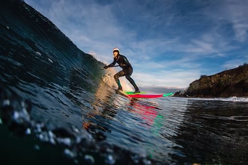 istock Stand Up Paddle surfing on waves. SUP board and surfer in wetsuit in morning 1196363998