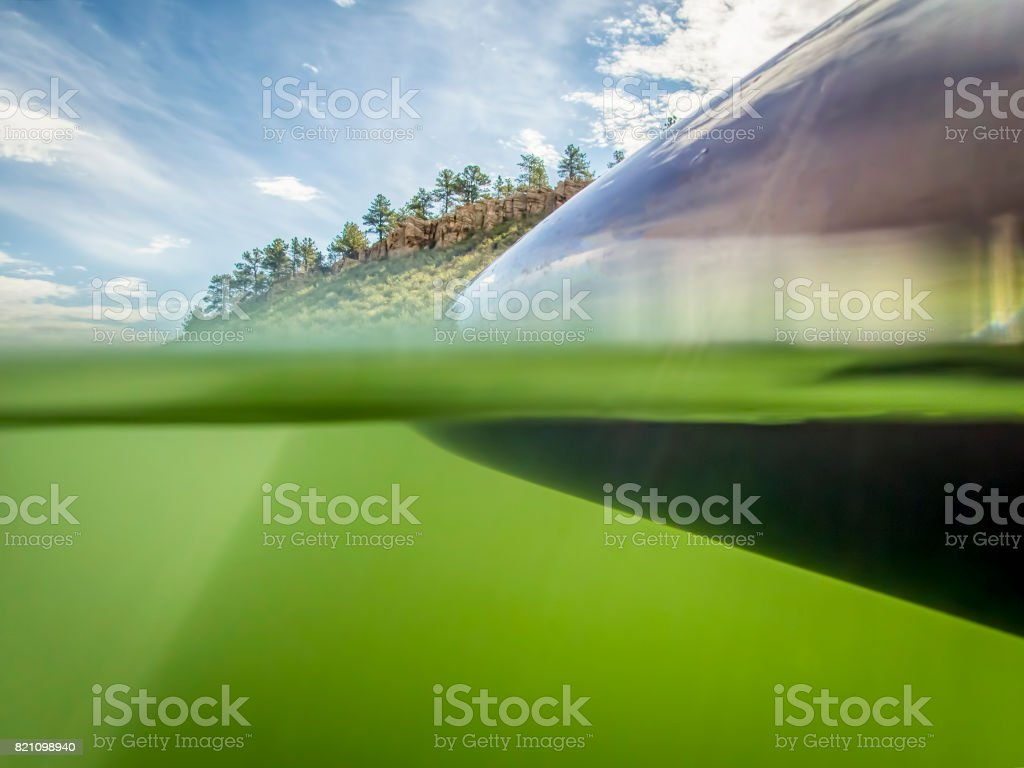 Stand up paddleboard on a mountain lake, stock photo
