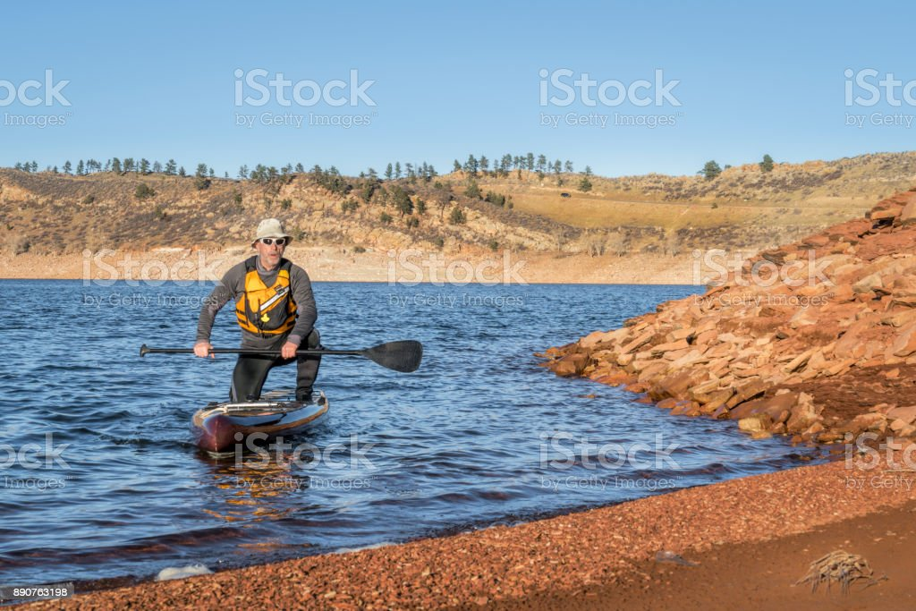 stand up paddleboard on Horsetooth Reservoir stock photo