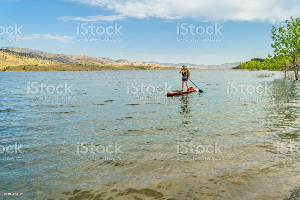 stand up paddleboard on lake in Colorado stock photo