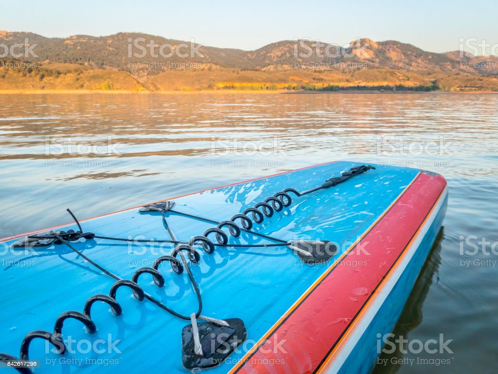 stand up paddleboard with a leash stock photo
