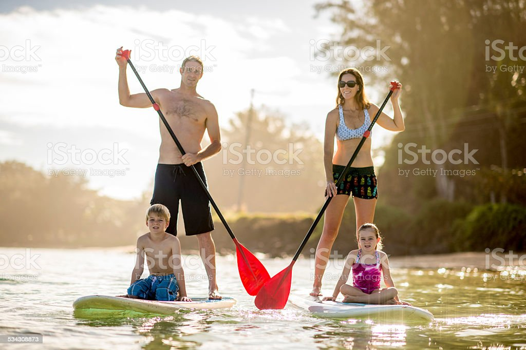 SUP - Stand up paddleboarding family stock photo