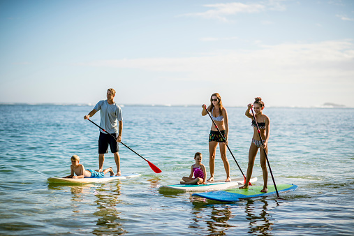 istock SUP - Stand up paddleboarding family 534365483