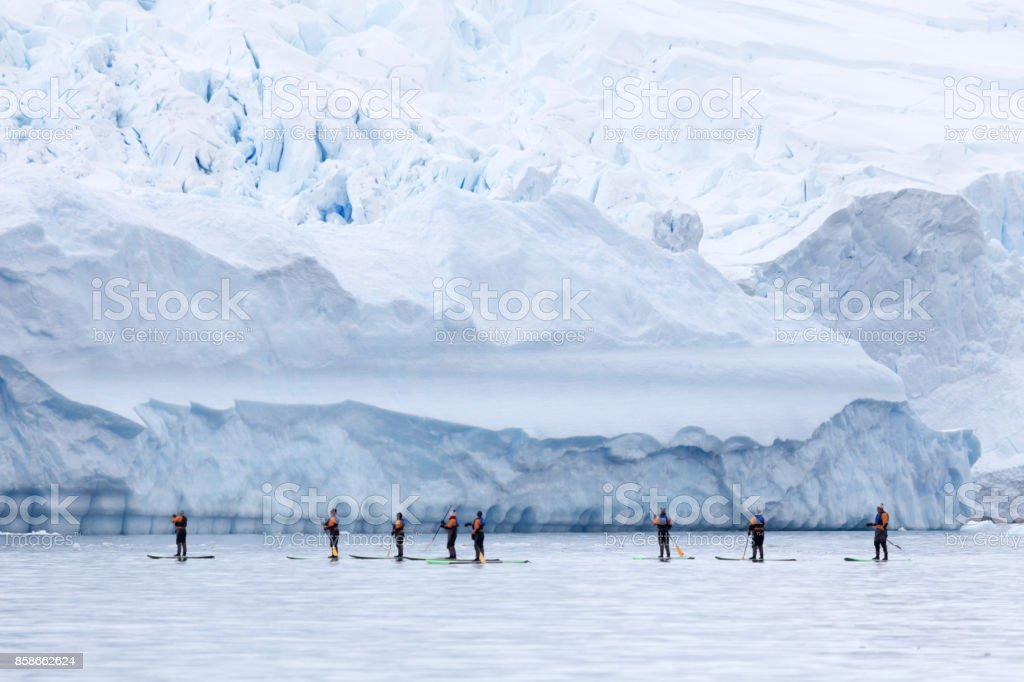 Stand up paddleboarding in the Antarctic Peninsula stock photo