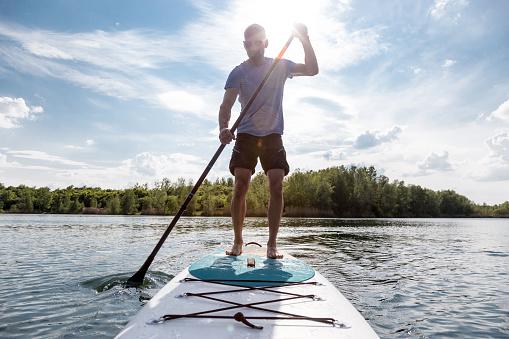 Stand up paddling on a lake