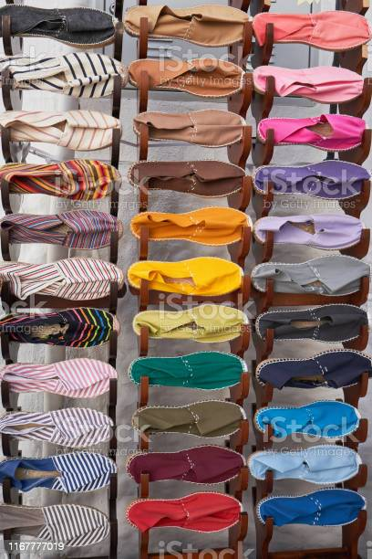 Stand with many fabric espadrilles of different colors picture id1167777019?b=1&k=6&m=1167777019&s=612x612&h=4vpag8e97vqcar1ujb29x2tdwwriaqy9vsdlzcbuzvy=