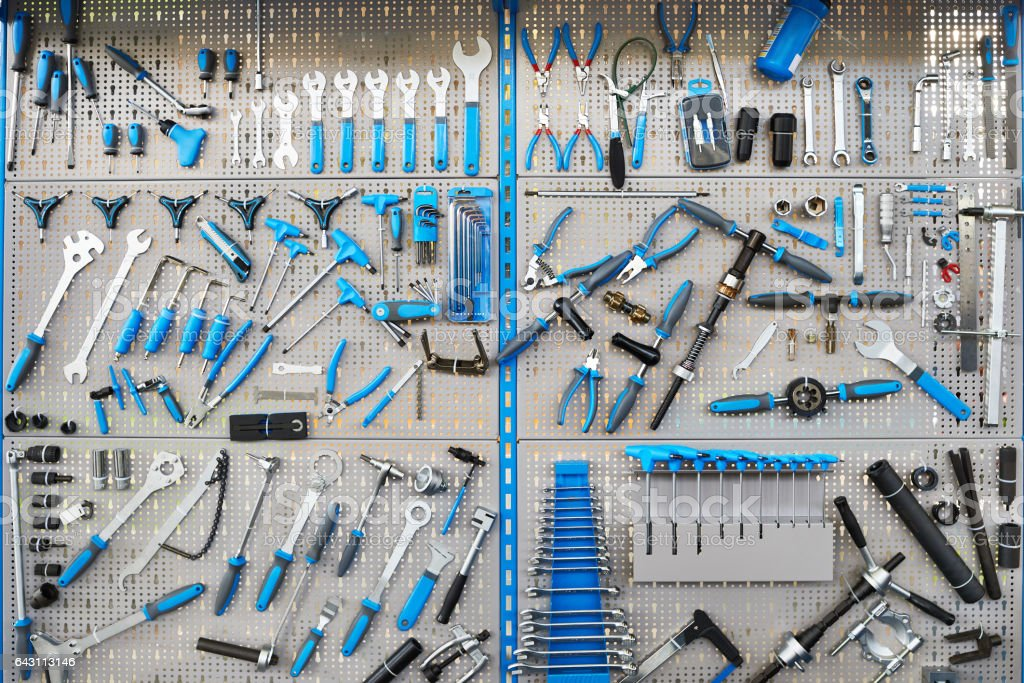Stand with set tools on bicycle workshop Big stand with set tools on bicycle workshop Work Tool Stock Photo