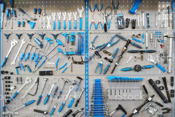 Stand With Set Tools On Bicycle Workshop Stock Photo - Download Image Now