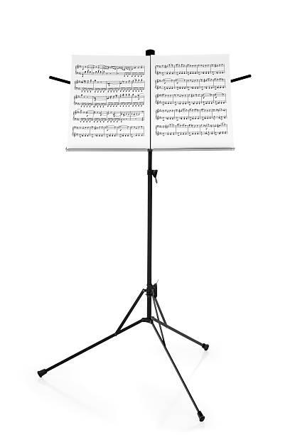 stehst mit notenblatt - piano noten stock-fotos und bilder