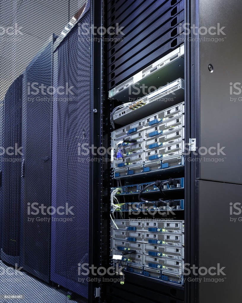 stand with supercomputers of the modern data center with the door open and entrails stock photo