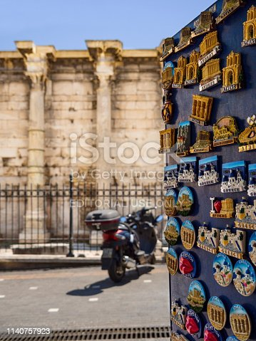 istock Stand with tourist magnets opposite the Library of Hadrian in the tourist area of Monastiraki 1140757923