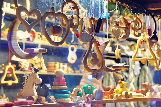 Stand with wooden toys and Christmas tree decorations stock photo