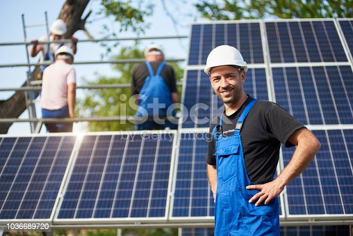 istock Stand-alone exterior solar panel system installation, renewable green energy generation concept. 1036689720