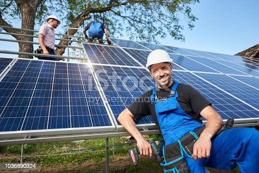 istock Stand-alone exterior solar panel system installation, renewable green energy generation concept. 1036690324