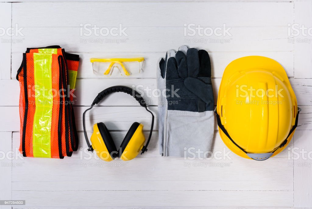 Standard construction safety equipment on wooden table. top view stock photo